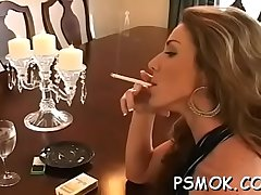Charming babe sucks a dick like a drab while smokin'_ a cig