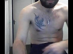 Bearded and tattoed alms-man showing his cock again