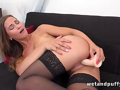 Teen with perky tits tests dildo hither the living room