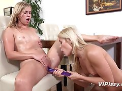 Slim blondes extract each other's pee using dildo
