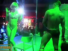 Hot blonde stripper on stage with male partner