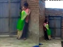 School students kissing in background in school