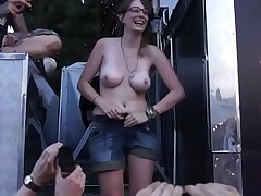Cute girl shows soul increased by ass on a festival stage